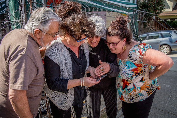 Two generations of Partos Clark Jewish Australian-Hangarians, checking on Quirky Berkeley on an iPhone, March 2015.  Robin Clark (father of daughters), daughter Erika, Julie, Monika (daughter).