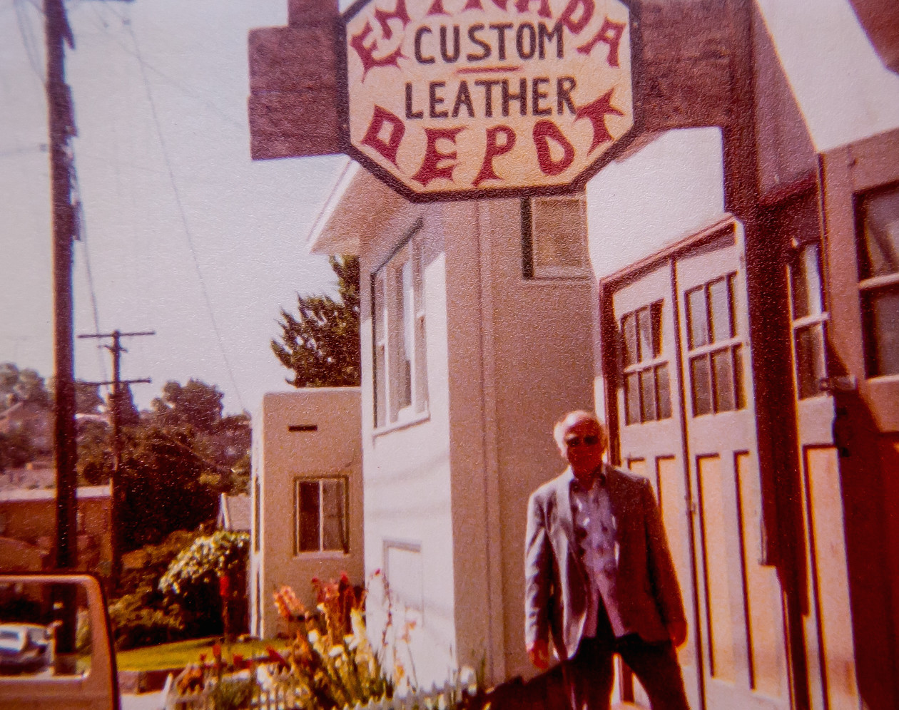 Art's father Al Ratner under leather shop sign.  Photo courtesy of Art Ratner