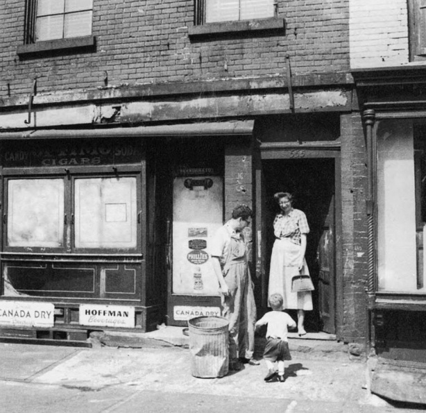 Jane Jacobs, husband and son in front of their home at 555 Hudson Street.