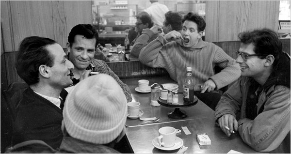 A late-1950s New York deli.  Clockwise from far right, Allen Ginsberg, Gregory Corso (in cap), the painter Larry Rivers, Jack Kerouac and the musician David Amram.