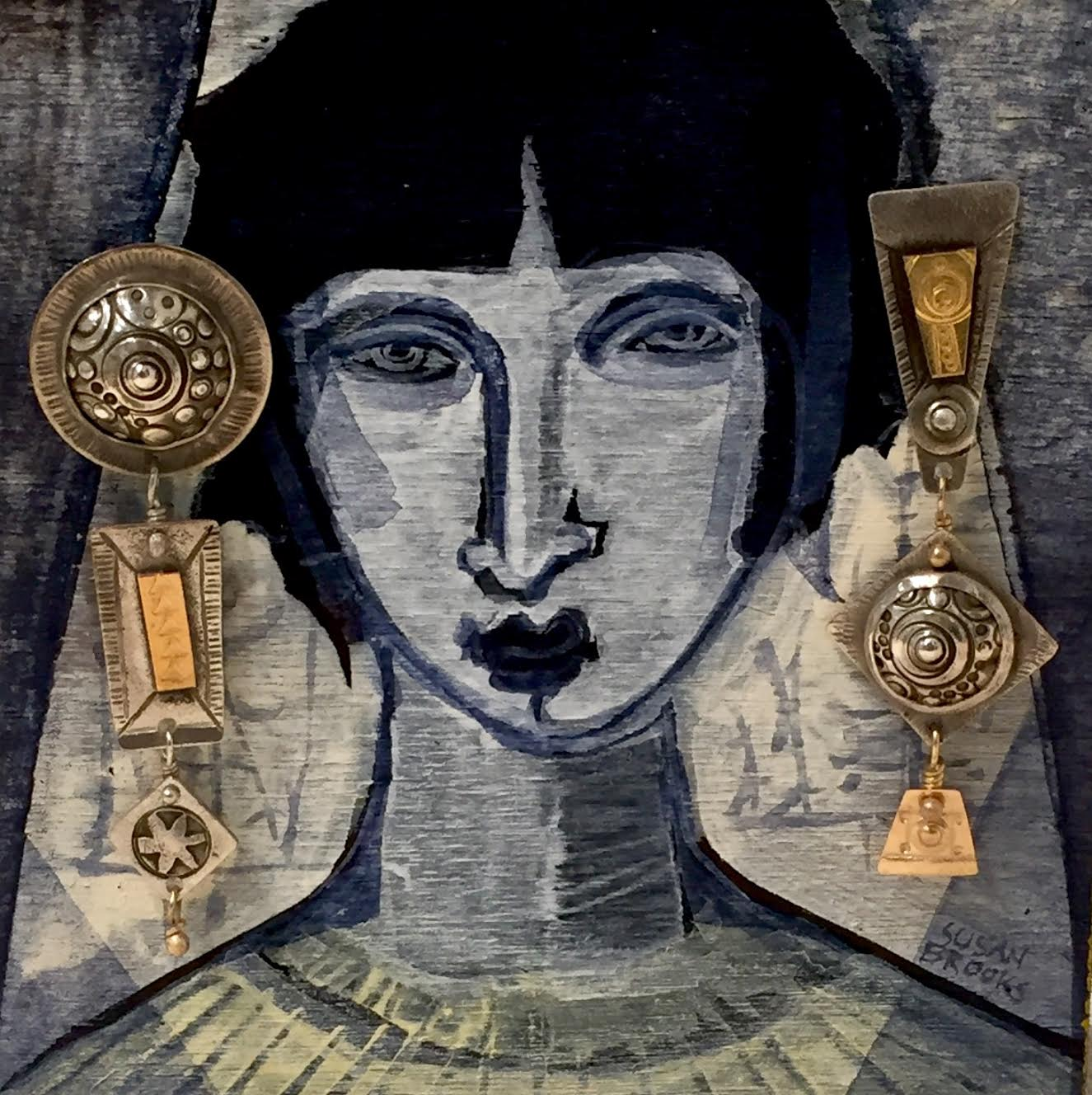 Hand-fabricated sterling and gold earrings displayed on a painting by Susan Brooks.  Photo by Susan Brooks
