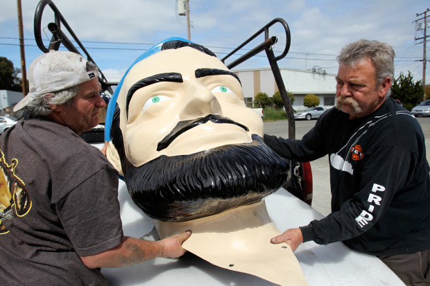 Barry Baber and Skip Merrill, of Hayward, deliver the head of Big Mike the Muffler Man/Paul Bunyan fiberglass statue to his new home at Bell Plastics in Hayward, Calif., on Wednesday, March 27, 2013.  (Anda Chu/East Bay Times Staff Archives
