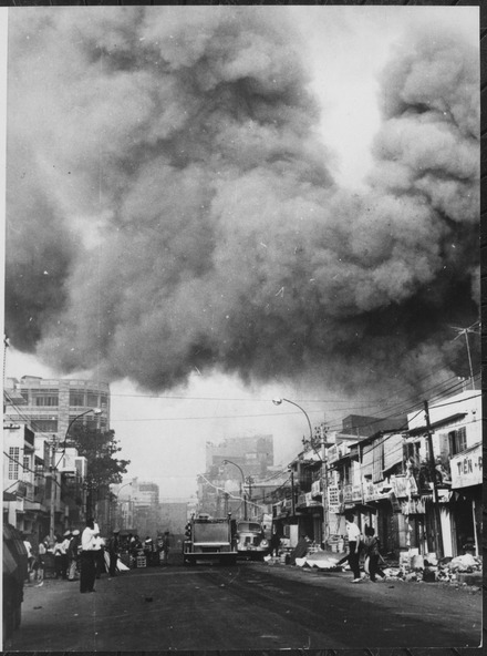 lossy-page1-440px-Black_smoke_covers_areas_of_the_capital_city_and_fire_trucks_rush_to_the_scenes_of_fires_set_during_attacks_by_the_Viet_-_NARA_-_541874.tif