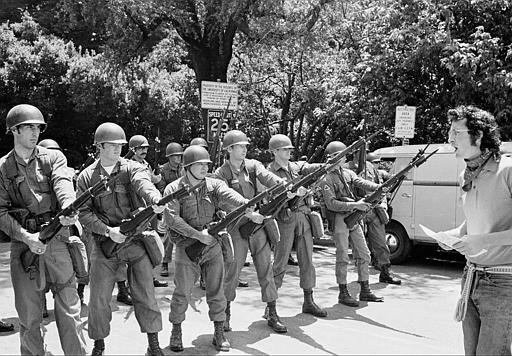 A lone demonstrator stays behind to argue with the National Guards troops who moved in to help California Highway patrolmen break up an unauthorized rally on the University of California Campus in Berkeley, Ca., Friday, May 16, 1969.  The guard was called by Gov. Ronald Reagan Thursday after a bloody riot over the fencing of People's Park, which had been built on school property.  Several persons were shot when police opened fire with shotguns filled with birdshot.  (AP Photo)