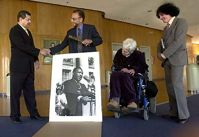 L to R: Gathered at the Martin Luther King, Jr. Student Union on Friday, May 17, 2002, Ronald Stevenson, Charles Henry, Helen Nestor and Harold Adler unveiled a photograph of Martin Luther King, Jr. speaking on Sproul Plaza. (Photo by Noah Berger)