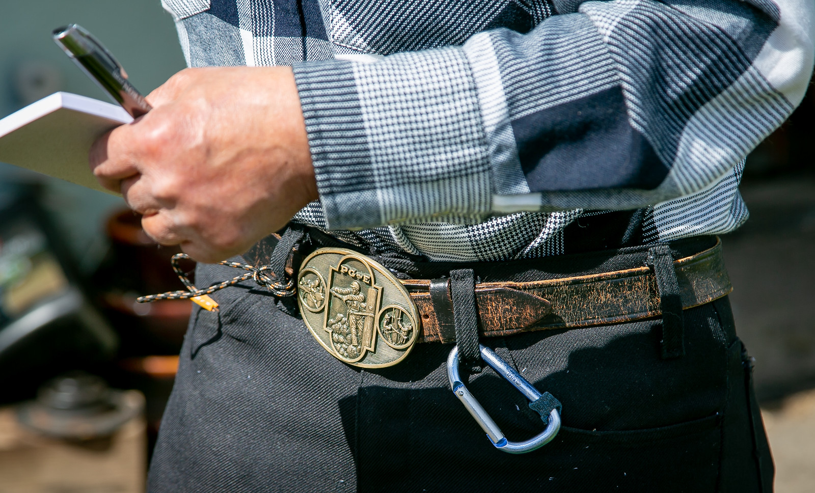 Lineman memorabilia collector, Bobo, at his home in San Juan Baptista, Calif. on March 29th, 2019.  belt buckle sold to benefit lineman's wife