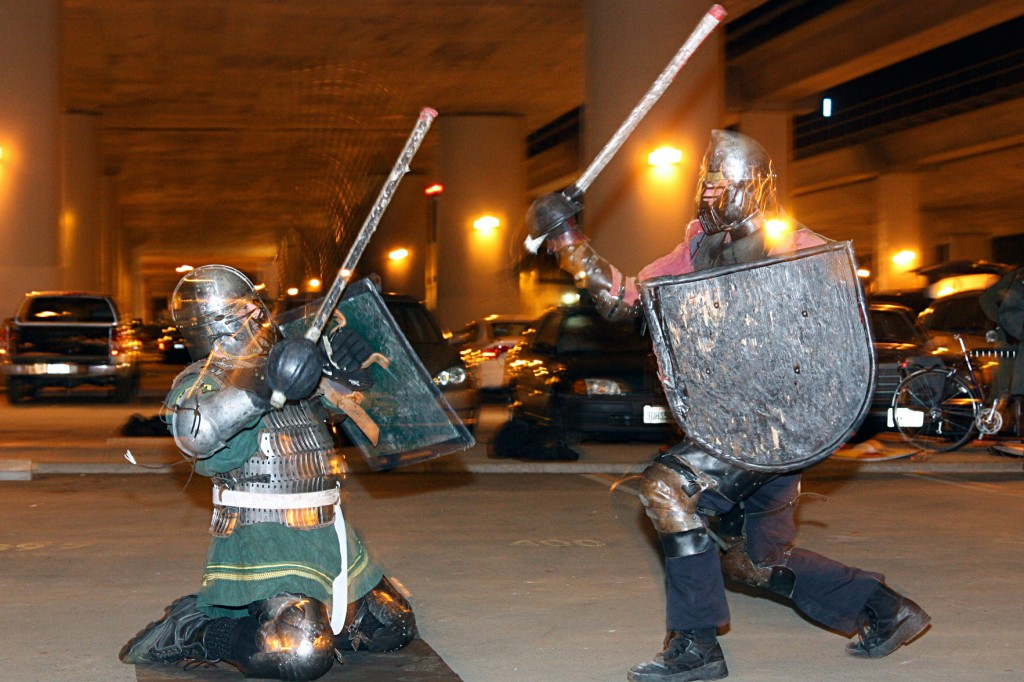Photo: https://oaklandnorth.net/2011/04/26/armor-clad-knights-reenact-sword-battles-under-the-rockridge-bart/